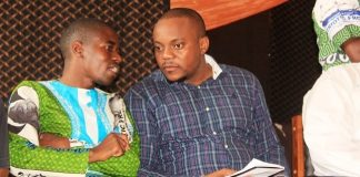 Copperbelt Province P atriotic Front Youth Chairperson, Nathan Chanda (left) confers with PF Media Deputy Director, Antonio Mwanza during the PF Copperbelt Mobilization meeting in Lufwanyama District