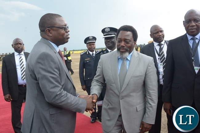 Foreign Affairs Minister Joseph Malanji bids farewell to President Joseph Kabila shortly before his departure at Kenneth Kaunda International Airport