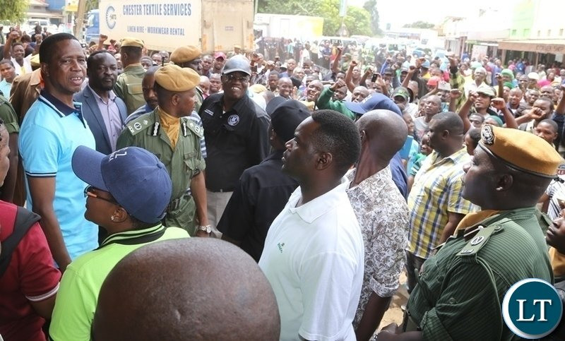 Kamwala Market business men and women welcomes President Edgar Lungu at the market during the Presidential fundraising walk on the completion of the Multi-Purpose Hall at RCZ Kamwala Congregation