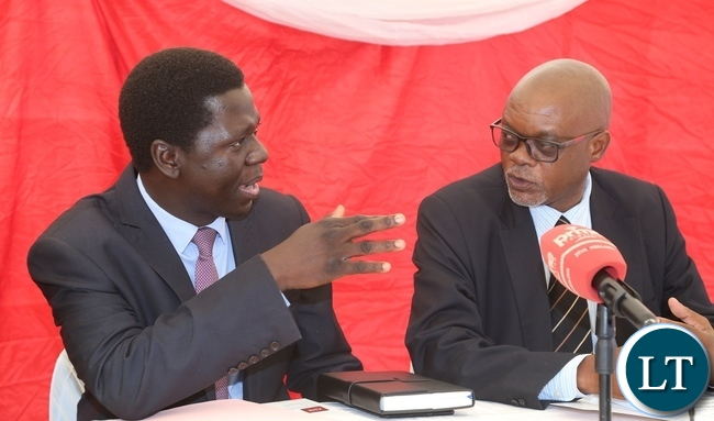 Ministry of Health Director Public Health Dr. Andrew Silumesii confers with Acting Director General National AIDS Council Fortune Chibamba during the International Condom Day at Central Mall