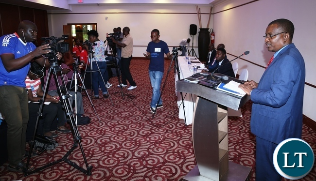 New Revolution Party President Humphrey Siulapwa speaking to  journalists during press briefing at Pamondzi Hotel