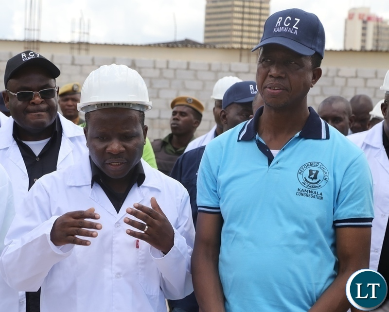 Rev. Daniel Daka confers with President Edgar Lungu during the touring the site of the church RCZ Kamwala Congregation