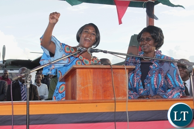 PF Deputy Secretary General Mumbi Phiri (l) raises the party symbol as Vice President Inonge Wina (r) Looks on arrival at Mongu Airport for a two-day working visit to inspect government developmental projects in Western Province