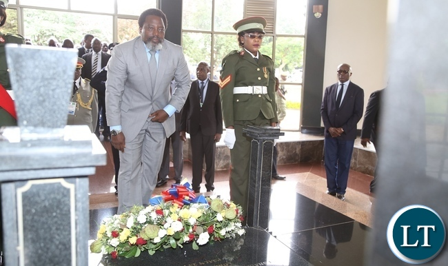 President Joseph Kabila laying wreaths at late President Fredrick Chiluba tomb stone during the tour of Presidential burial site in Lusaka