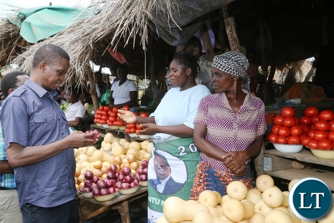 President Edgar Lungu intarects with marketers at John Chinena during the tour of Chibombo District in Central Province