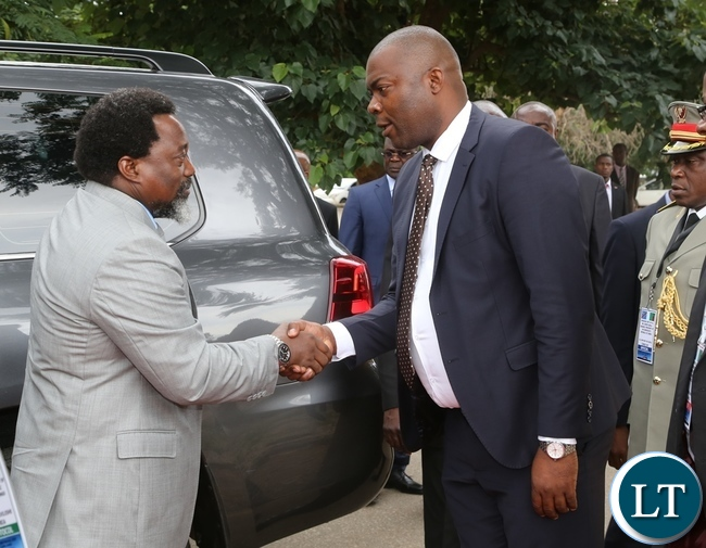 Lusaka Province Minister Bowman Lusambo welcomes President Joseph Kabila at the Presidential burial site in Lusaka