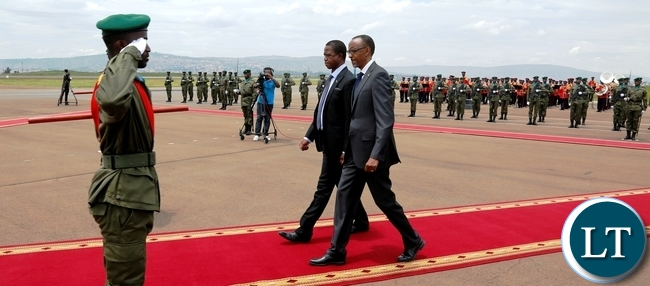 President Edgar Chagwa Lungu (centre) accompanied by his Rwandan Counterpart Paul Kagame being saluted as they inspect the guard of honour at Kigali International Airport in Rwanda on Wednesday,February 21,2018. PICTURE BY SALIM HENRY/STATE HOUSE ©2018