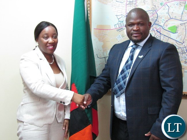 Africa Development Bank (ADB) Country Manager Mary Manneko Monyau with Minister of National Development Planning Alexander Chiteme