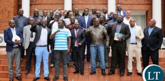 President Lungu poses for a photo with Jerabos after a meeting at State House on Friday.