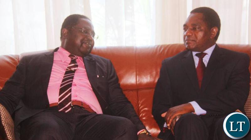 Bishop Imakando confers with HH