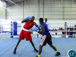 Benny Muziyo (Red) knocking out Malawian boxer Elias Kassim (Blue).Courtesy of OYDC