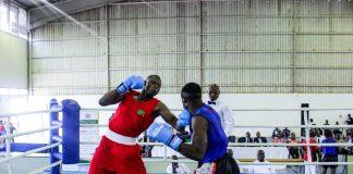 Benny Muziyo (Red) knocking out Malawian boxer Elias Kassim (Blue).Courtesy of OYDC