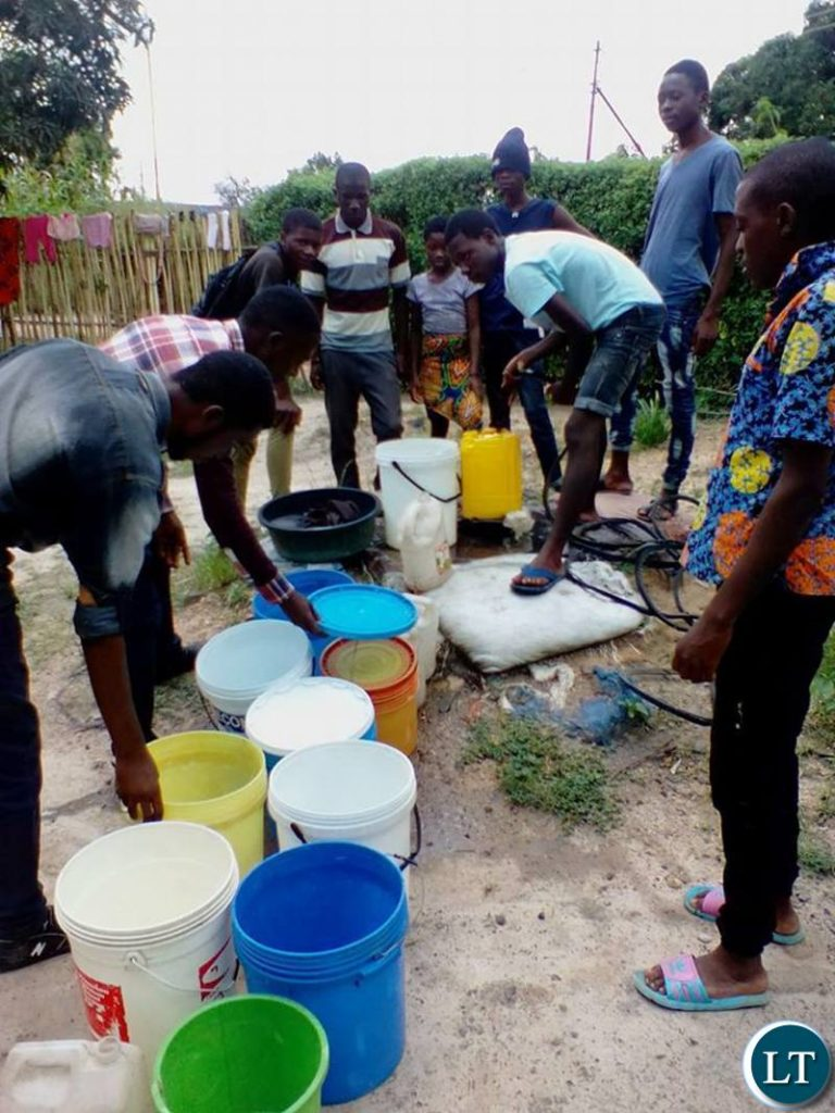 Mpatamatu residents drawing water from wells