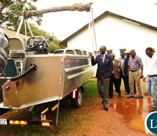 Northern Province PS Elias Kamanga inspects the newly purchased boat for Ministry of Agriculture in Chilubi district during his continued feminization tour of various departments at Provincial Agriculture office in Kasama today. Looking on Acting PACO Muzeta .: picture by Mary Bwembya (ZANIS)