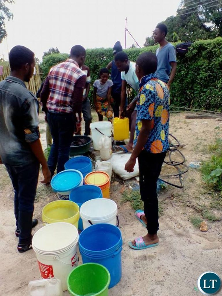 Queing up for water from shallow wells in Mpatamatu
