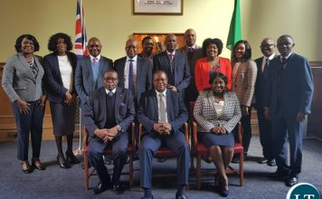 Zambia High Commission London Staff pose for a picture with Dr. Simwinga.