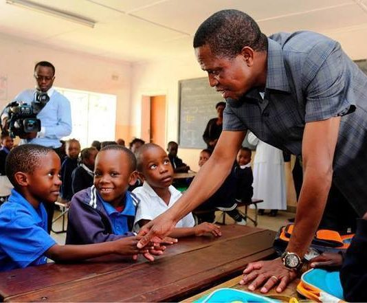 President Edgar Chagwa Lungu (left) autographs the visitors book during his visit to Divine Providence Convent School in Chawama,Lusaka on Friday,March 23,2018. PICTURE BY SALIM HENRY/STATE HOUSE ©2018