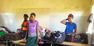Pupils at Myooye Secondary School in Mumbwa in a classroom with their personal belongings