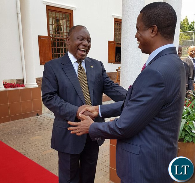South African President Cyril Ramaphosa. having a light moment with Zambian President Edgar Lungu