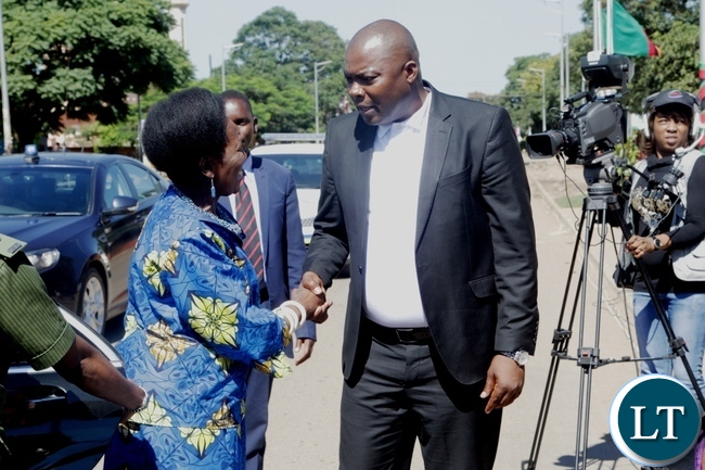 Vice President Inonge Wina is welcomed by Lusaka Province Minister Bowman Lusambo on arrival at the freedom statue for the international women's day commemoration
