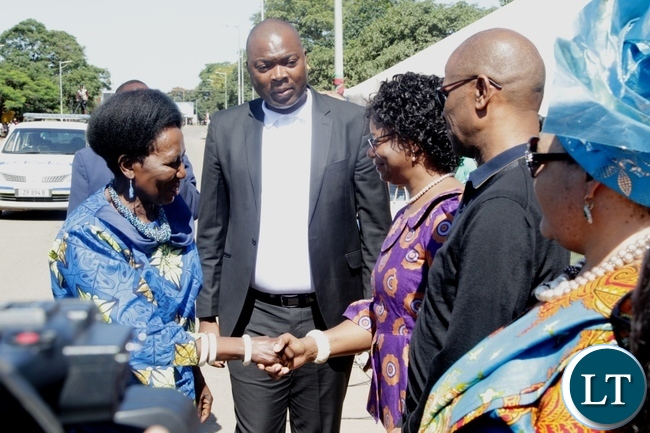 Vice President Inonge Wina is welcomed by 1st Deputy speaker of  National Assembly Catherine Namugala  on arrival at the freedom statue for the international women's day commemoration .looking on (center) is Lusaka Province Minister Bowman Lusambo
