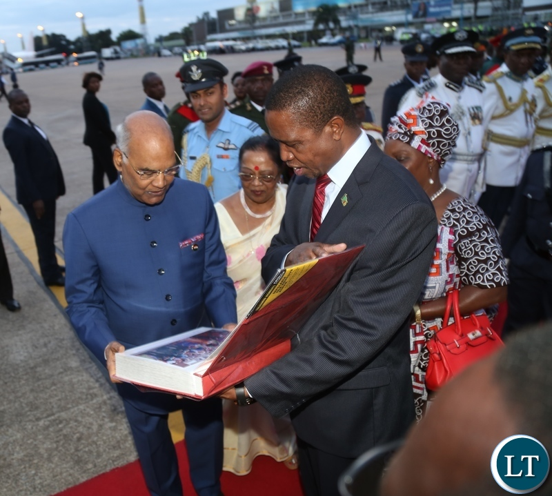 President Lungu and President of the Republic of India, Ram Nath Kovind admiring at the pictures presented to the President of India shortly before his departure at Kenneth Kaunda International Airport after concluding his three-day State Visit yesterday 11-04-2018. Picture by ROYD SIBAJENE