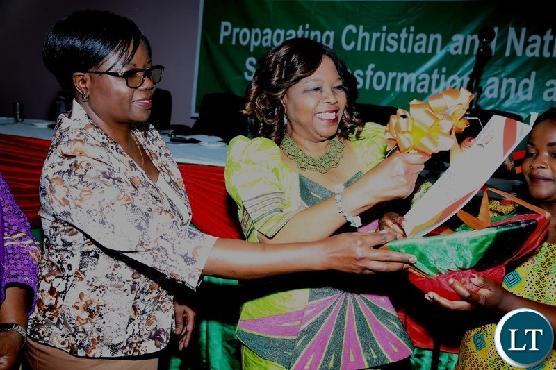 Minister of National Guidance and Religious Affairs Godfridah Sumaili cutting the ribbon whilst Permanent Secretary in the Ministry Katongo Chifwepa helps during the Launch of it's 2018-2021 Strategic Plan at Mulungushi International Conference Centre yesterday 25-04-2018. Picture by ROYD SIBAJENE/ZANIS