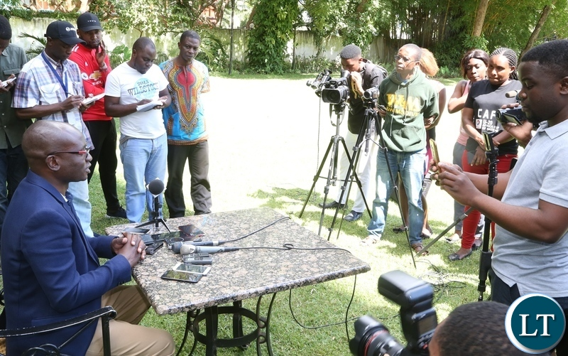 Special Assistant for Press and Public Relations to the President Amos Chanda speaking to journalists on the conduct of the Cuban Ambassador to Zambia Nelson Pages Vilas at the media briefing at Pamodzi Hote