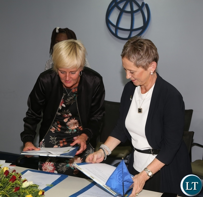 World Bank Country Manager Ian Ruthenberg and Swedish Embassy Deputy Head of Mission Karin Svernken exchange the Administrative Grant agreement between Government of Sweden and World Bank on Electricity Service Access Project after the signing ceremony