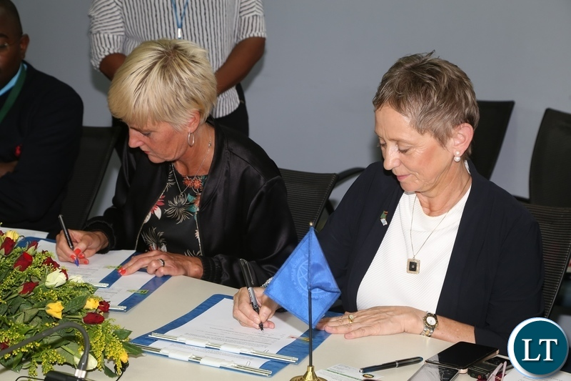 World Bank Country Manager Ian Ruthernberg and Swedish Embassy Deputy Head of Mission Karin Svernken signing the Administrative Grant agreement between Government of Sweden and World Bank on Electricity Service Access Project during the signing ceremony