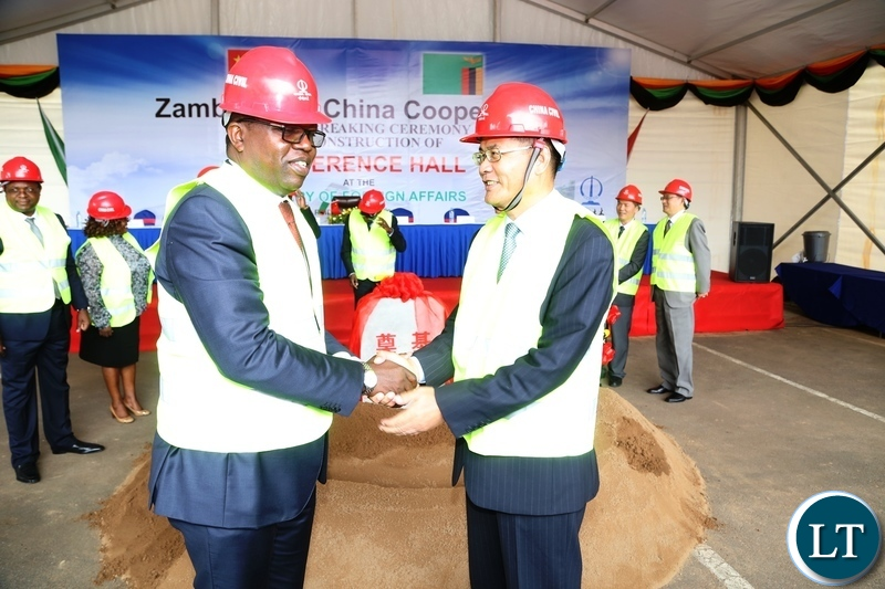 Minister of Foreign Affairs Joe Malanji shake hands with outgoing Chinese Ambassador Yang Youming shortly after the ground breaking ceremony of the construction of Conference hall at Foreign Affairs