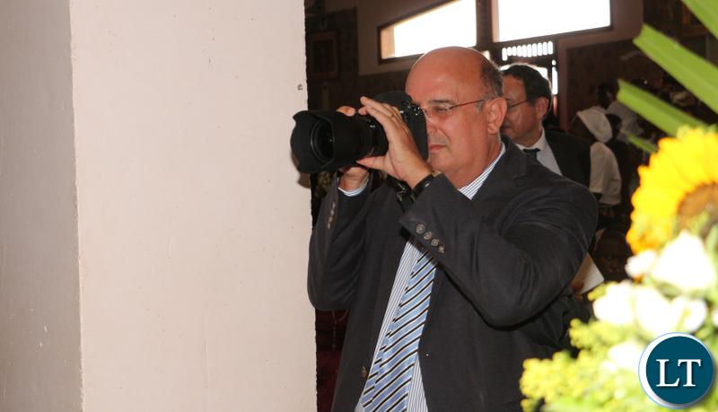 Italian ambassador to Zambia  Filippo Scammacca getting pictures.