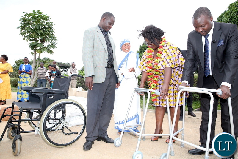 The Esther Lungu has donates foodstuffs, a wheel chair and walkers to Mother Teresa in Kabwe on Friday, April 13,2017. Here, Kabwe Central member of Parliament Tutwa Ngulube and Esther Lungu Foundation Trust Programmes Coordinator Mildred Chuumbwe and Kabwe District Commissioner Dominic Mulenga hands over a donation to Sr Sharli -Picture by THOMAS NSAMA