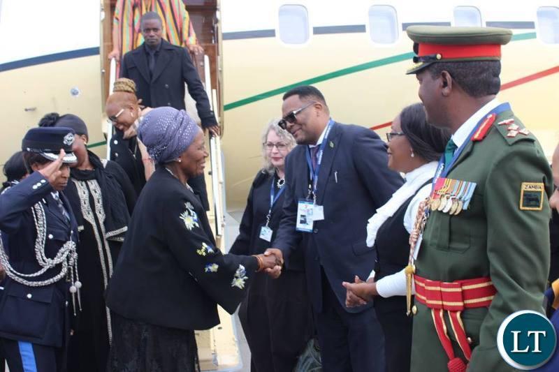 Vice President Inonge Wina greeting Zambia's Ambassador to South Africa Emmanuel Mwamba