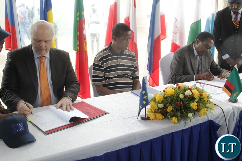 President Lungu witnessing the signing of financing agreement for small scale commercial farmers by Head of European Union Alesandrio Mariana and Fredson Yamba at the 5th Agriculture Expo in Chisamba