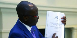 Presidential Spokesperson Amos Chanda showing a contract of Inyatsi companies signed months before the Presidenty became head of state.
