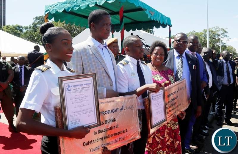 FROM LEFT TO RIGHT: Besa Mumba, President Edgar Chagwa Lungu, Kalengo Kamwenda and Labour Minister Joyce Nonde-Simukoko during the Labour Day Commemorations at Freedom Statue in Lusaka on Tuesday,May 1,2018. The young pilots were recipients of the Presidential Labour Awards. PICTURE BY SALIM HENRY/STATE HOUSE ©2018