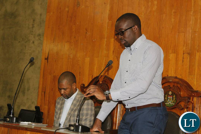 Kitwe Mayor Christopher Kangombe and Local Government and Housing Minister Vincent Mwale addressing representatives of Chisokone Marketeers at City Council Chambers