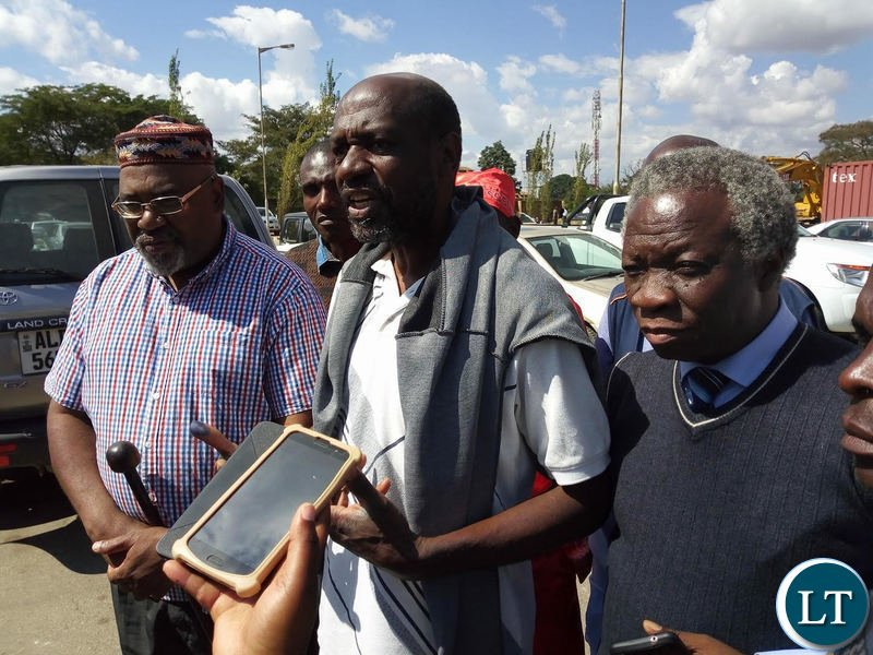 Mr Siwale (c) flanked by Mr Mulongoti and Mr Nason Msoni shortly after leaving court premises