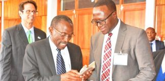 FIle Chiefs and Traditional Affairs Minister Lawrence Sichalwe (m) share notes with Eastern Province Permanent Secretary, Chanda Kasolo during the ICT 4D conference