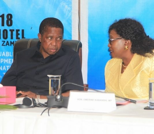 President Edgar Lungu confers with Community development Minister Emerine Kabanshi during the 6th community based rehabilitation (CBR)Africa conference held at Intercontinental Hotel