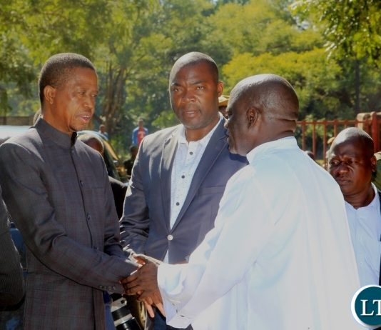 President Edgar Lungu is welcomed by Father Godfrey Mashilipa of Saint Marys Assumption Parish on arrival for a church service in Chilanga. Looking on (center)is Lusaka Province Minister Bowman Lusambo
