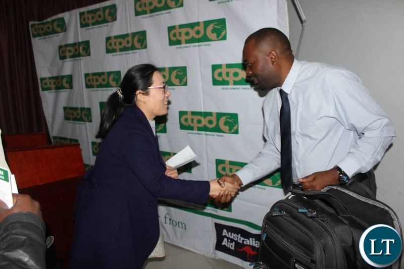 Trade Consultant Trevor Simumba chats with a Chinese Economic Counsellor from the Embassy of China to Zambia