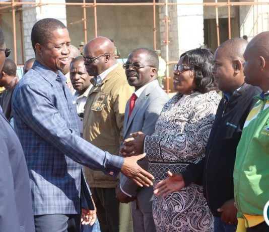 President Edgar Lungu having a light moment with PF members shortly before his departure to Eastern Province at City Airport