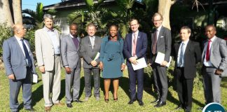 A group of EU Ambassadors meeting with FIC Director General Mary Tshuma ( in green) at the FIC Offices on Tuesday