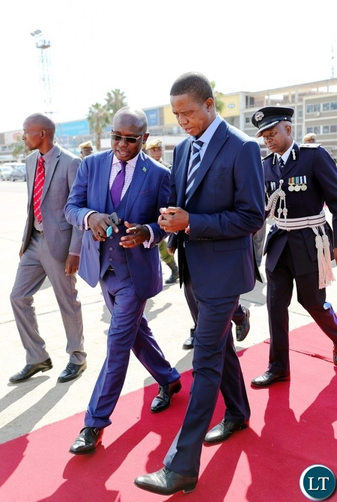 President Edgar Lungu with His Special Assistant for Press and Public Relations Mr Amos Chanda at Kenneth Kaunda International Airport before departure for a Private Visit to Kenya at the invitation of His counterpart President Uhuru Kenyatta, on Thursday, 14th June, 2018. Pictures by Eddie Mwanaleza/State House