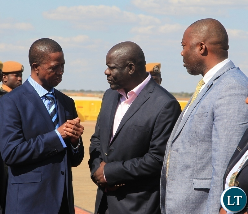 President Edgar Lungu confers Patriotic party Secretary General Davis Mwila  before departure for Kenya for a private visit at Kenneth Kaunda International Airport.looking on is Lusaka Province Minister Bowman Lusambo