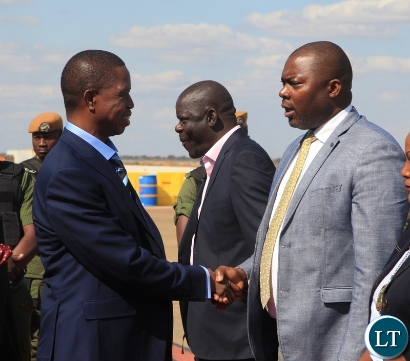 President Edgar Lungu bids farewell to   Lusaka Province Minister Bowman Lusambo before departure for Kenya for a private visit at Kenneth Kaunda International Airport