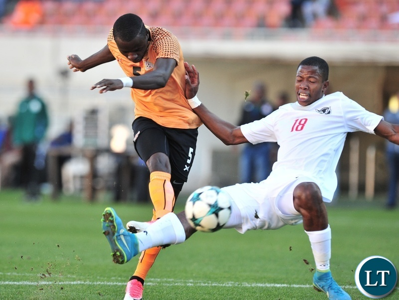 Lazarous Kambole of Zambia tackled by Vitapi Ngaruka of Namibia during the 2018 COSAFA match between Zambia and Namibia at Peter Mokaba Stadium, Polokwane on 02 June 2018 ©Samuel Shivambu/BackpagePix