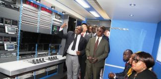ZNBC Technical Director with ZANIS Director Patrick Lungu showing Information Minister Dora Siliya the inside of the newly acquired ZNBC Outside- Broadcasting Trucks during the handover tour.